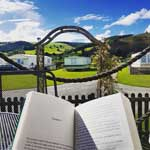relax with a book at Hendwr Caravan Park